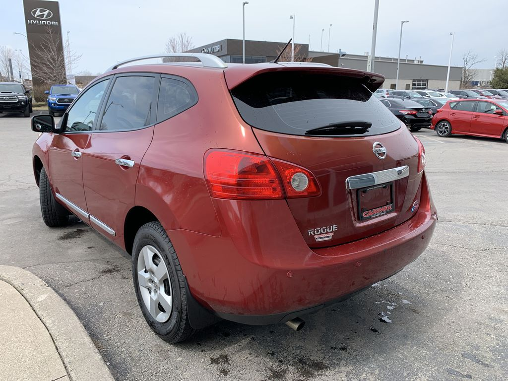 Red[Ignition Red Pearl] 2011 Nissan Rogue Left Front Interior Door Panel Photo in Brampton ON