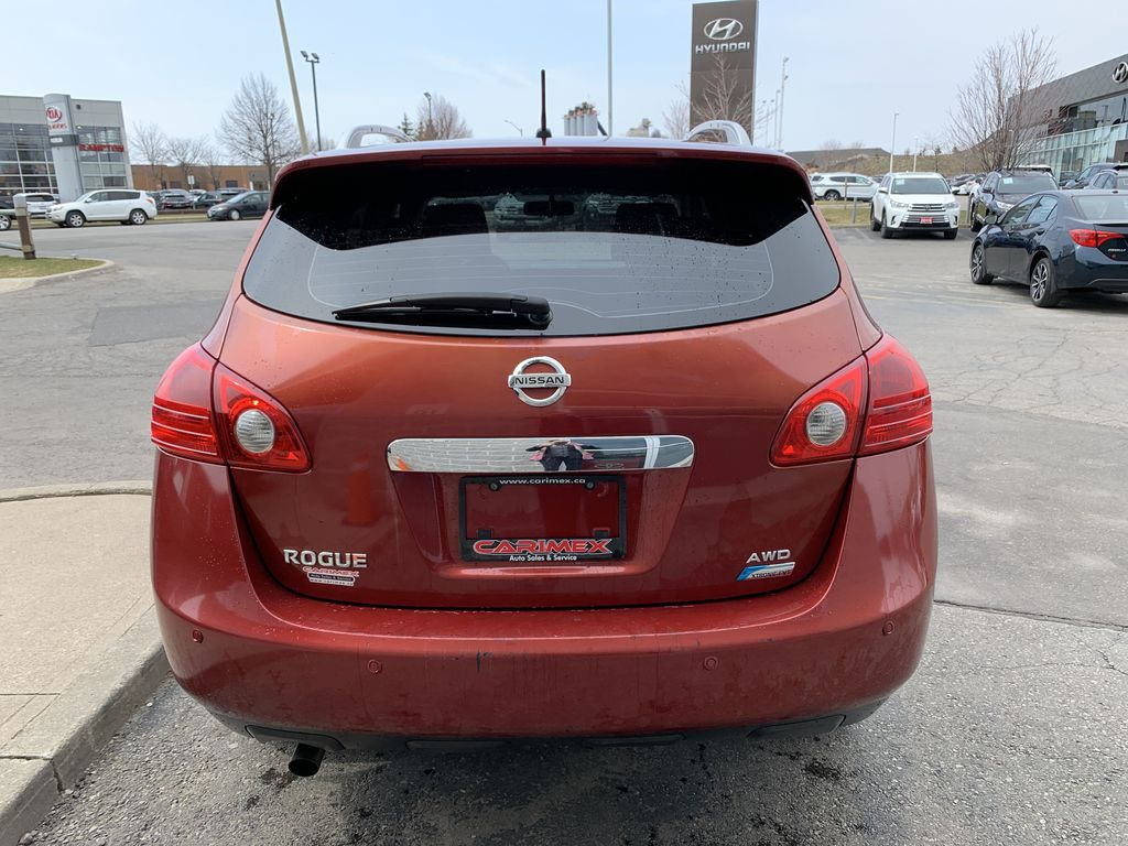 Red[Ignition Red Pearl] 2011 Nissan Rogue Left Front Interior Photo in Brampton ON