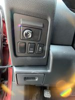 Red[Ignition Red Pearl] 2011 Nissan Rogue Center Console Photo in Brampton ON