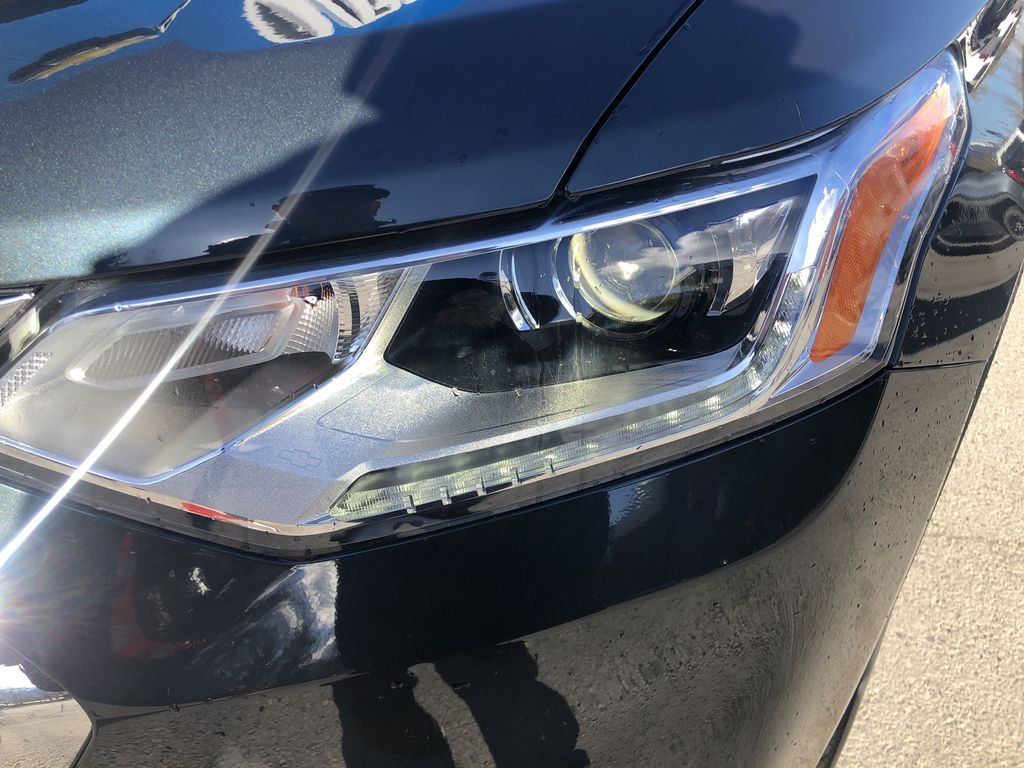 Gray[Graphite Metallic] 2021 Chevrolet Traverse LT Left Front Head Light / Bumper and Grill in Canmore AB
