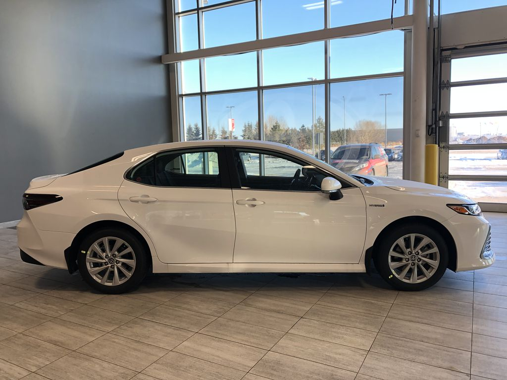 Super White 2021 Toyota Camry Hybrid LE Right Rear Corner Photo in Edmonton AB