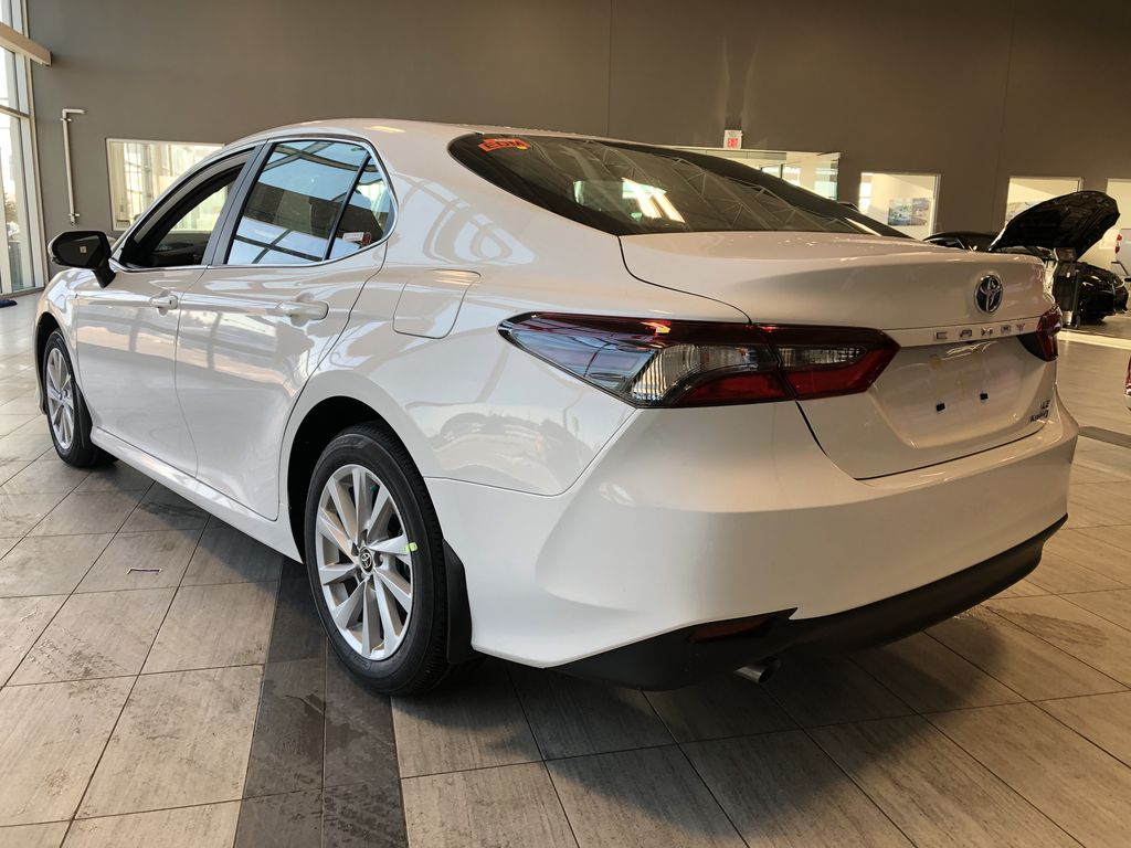 Super White 2021 Toyota Camry Hybrid LE Left Rear Corner Photo in Edmonton AB