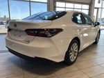 Super White 2021 Toyota Camry Hybrid LE Rear of Vehicle Photo in Edmonton AB