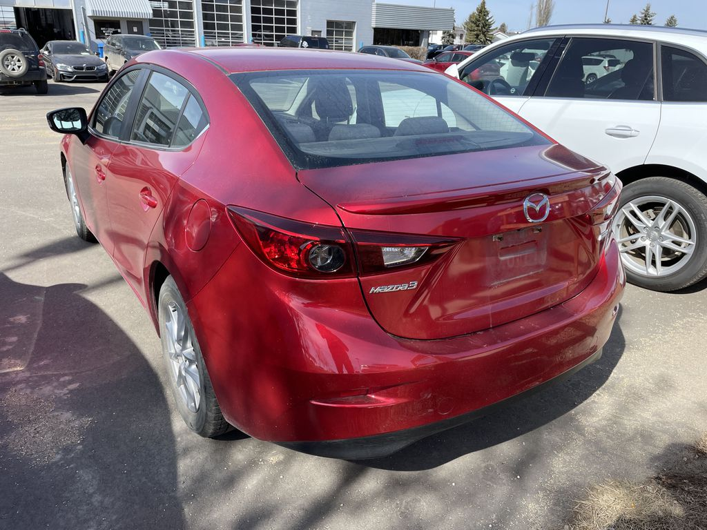 RED 2014 Mazda Mazda3 GS - Left Front Rim and Tire Photo in Edmonton AB
