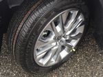 0070 Blizzard Pearl 2021 Toyota Highlander Left Front Rim and Tire Photo in Kelowna BC