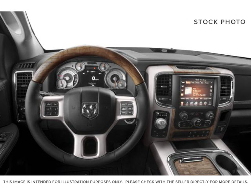 Silver[Bright Silver Metallic] 2018 Ram 1500 Steering Wheel and Dash Photo in Fort Macleod AB