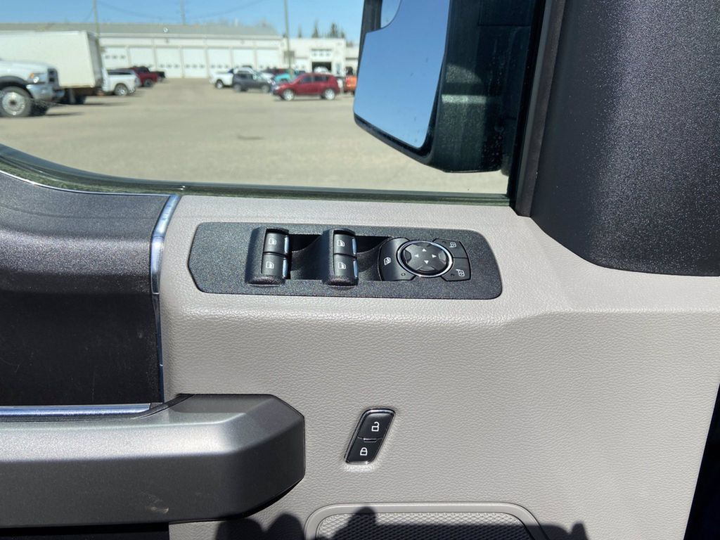 Blue[Blue Jeans Metallic] 2018 Ford F-150 Left Front Interior Photo in Brandon MB