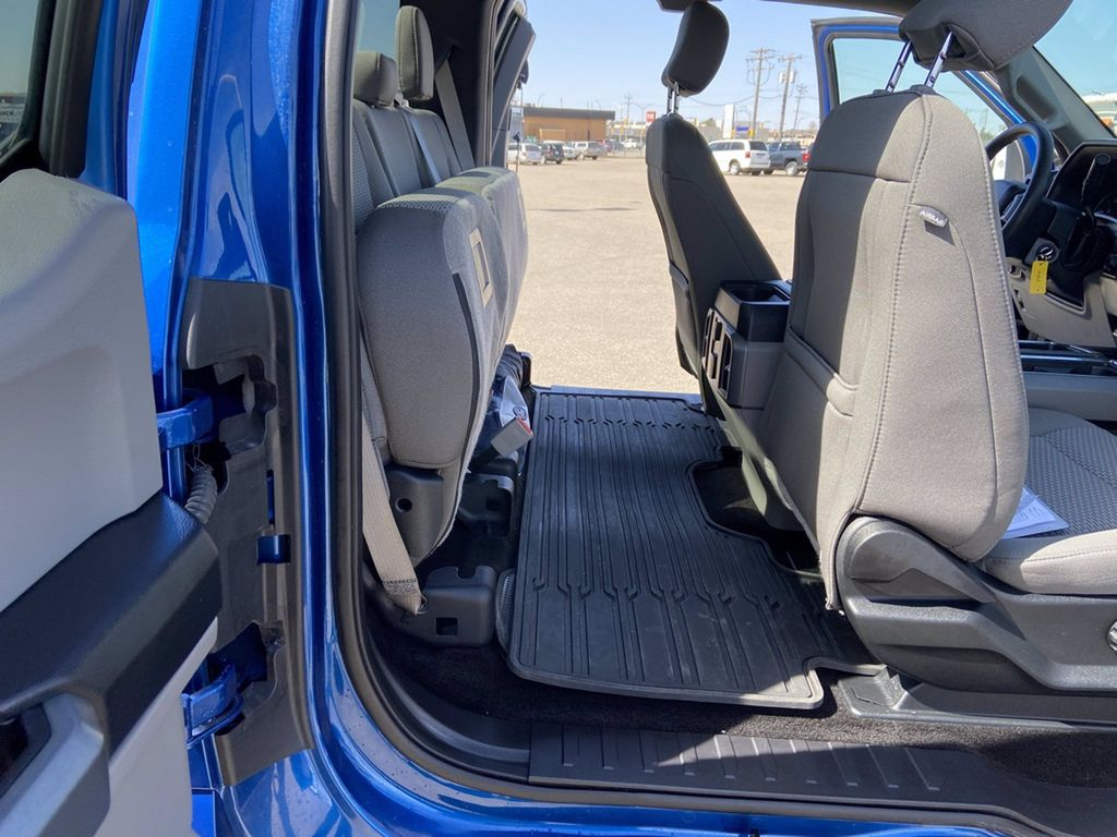 Blue[Blue Jeans Metallic] 2018 Ford F-150 Steering Wheel and Dash Photo in Brandon MB