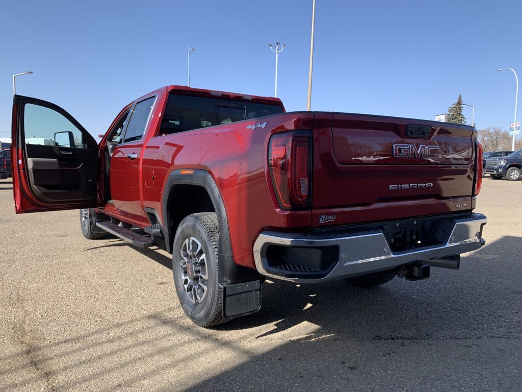 Red 2021 GMC Sierra 2500HD Left Front Rim and Tire Photo in Brooks AB