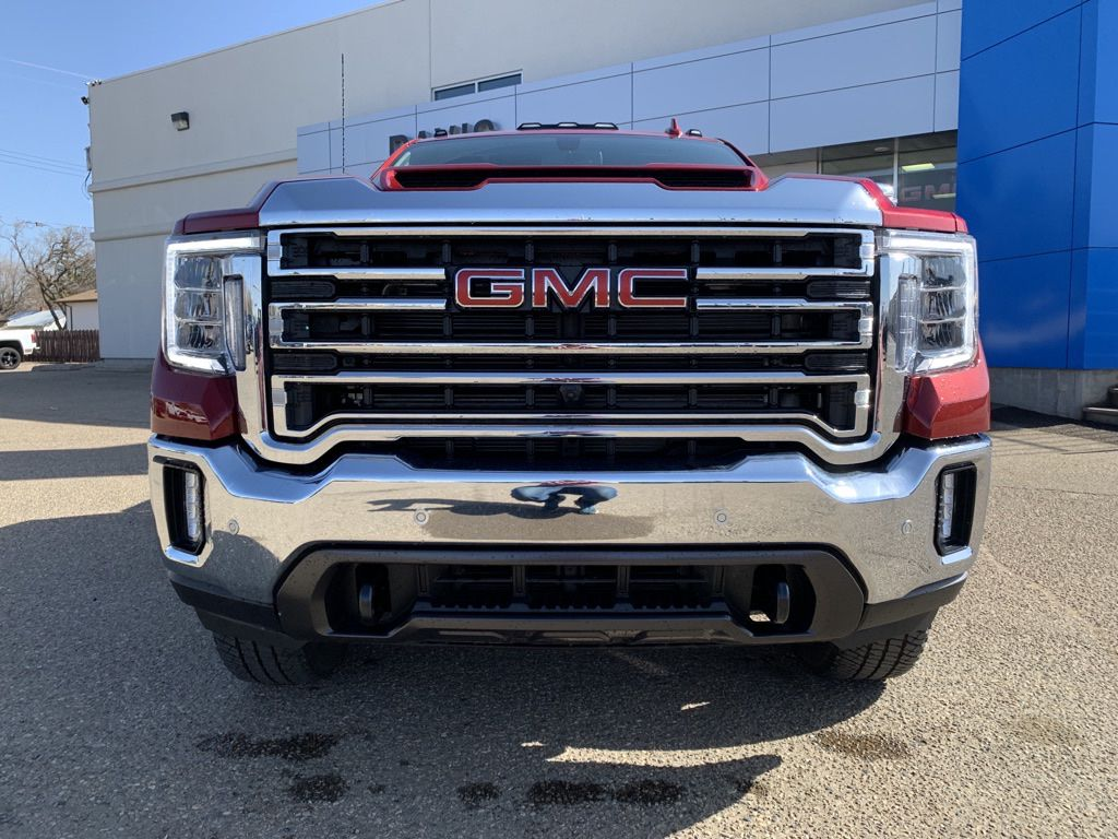 Red 2021 GMC Sierra 2500HD Left Front Head Light / Bumper and Grill in Brooks AB