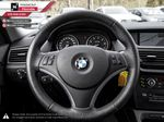 White[Alpine White] 2012 BMW X1 Right Side Front Seat  Photo in Kelowna BC
