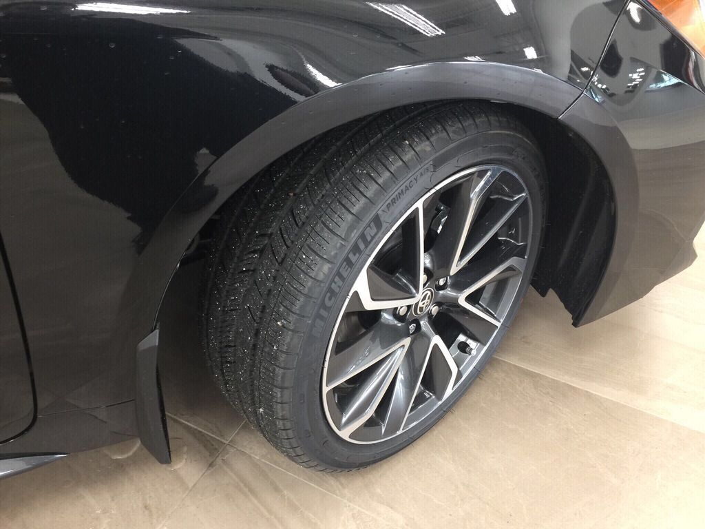 Black[Black Sand Pearl] 2021 Toyota Corolla SE Upgrade Right Front Rim and Tire Photo in Sherwood Park AB
