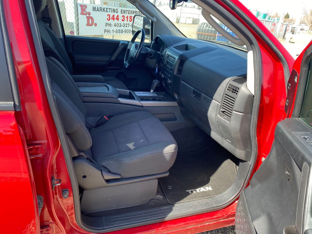 Red[Matador Red] 2011 Nissan Titan Right Side Front Seat  Photo in Lethbridge AB