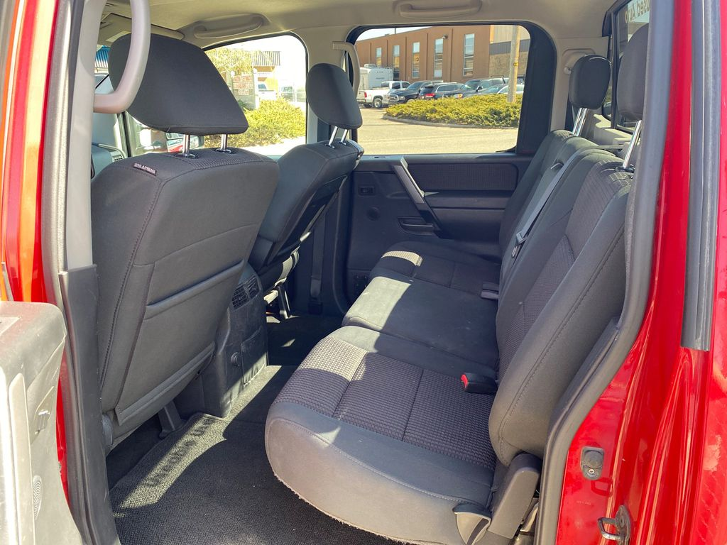 Red[Matador Red] 2011 Nissan Titan Left Side Rear Seat  Photo in Lethbridge AB