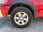 Red[Matador Red] 2011 Nissan Titan Left Front Rim and Tire Photo in Lethbridge AB