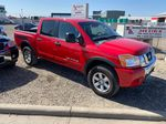 Red[Matador Red] 2011 Nissan Titan Right Side Photo in Lethbridge AB