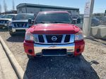 Red[Matador Red] 2011 Nissan Titan Front Vehicle Photo in Lethbridge AB