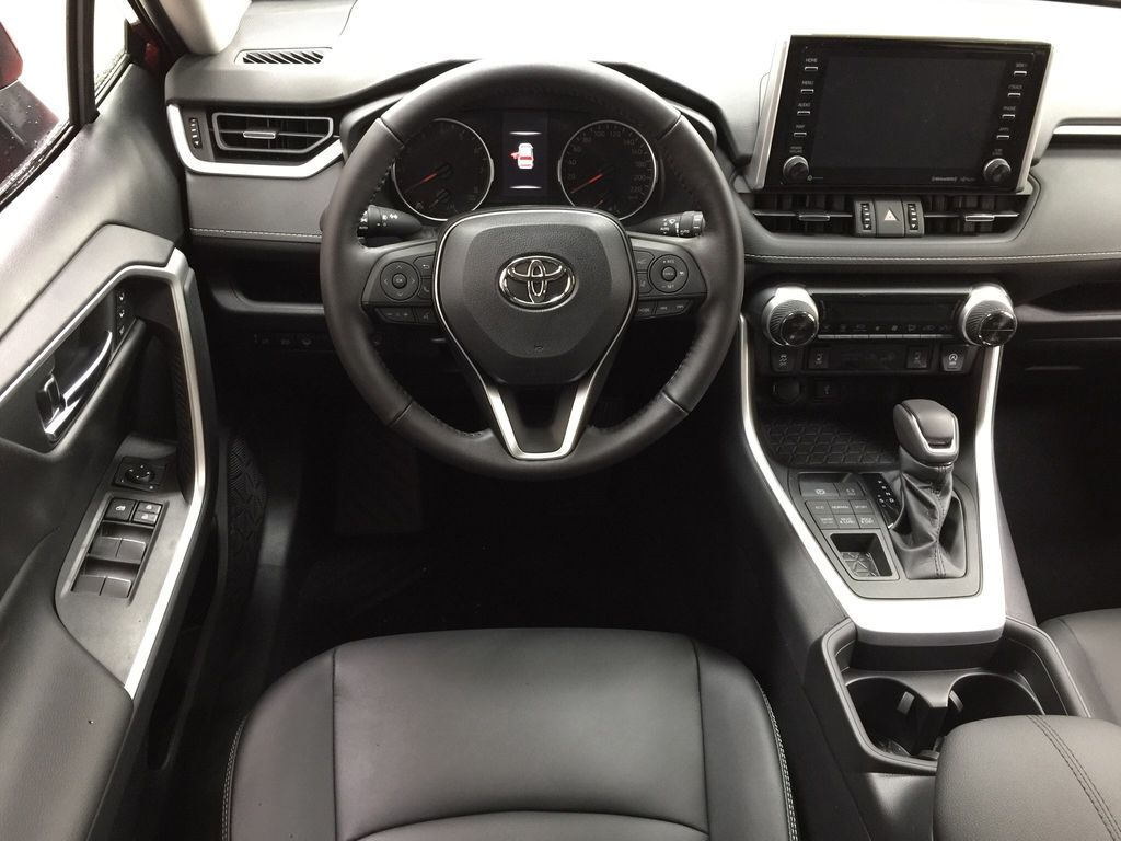Red[Ruby Flare Pearl] 2021 Toyota RAV4 XLE Premium Left Front Seat Photo in Sherwood Park AB