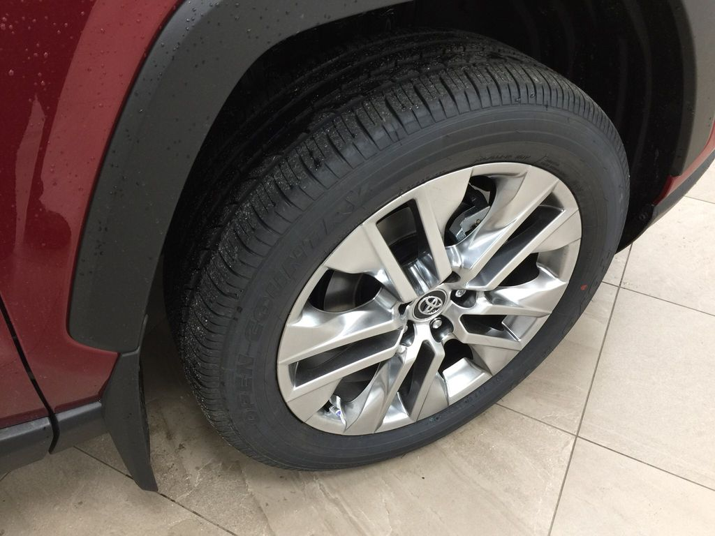 Red[Ruby Flare Pearl] 2021 Toyota RAV4 XLE Premium Right Front Rim and Tire Photo in Sherwood Park AB
