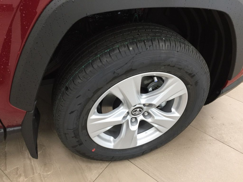 Red[Ruby Flare Pearl] 2021 Toyota RAV4 XLE AWD Right Front Rim and Tire Photo in Sherwood Park AB