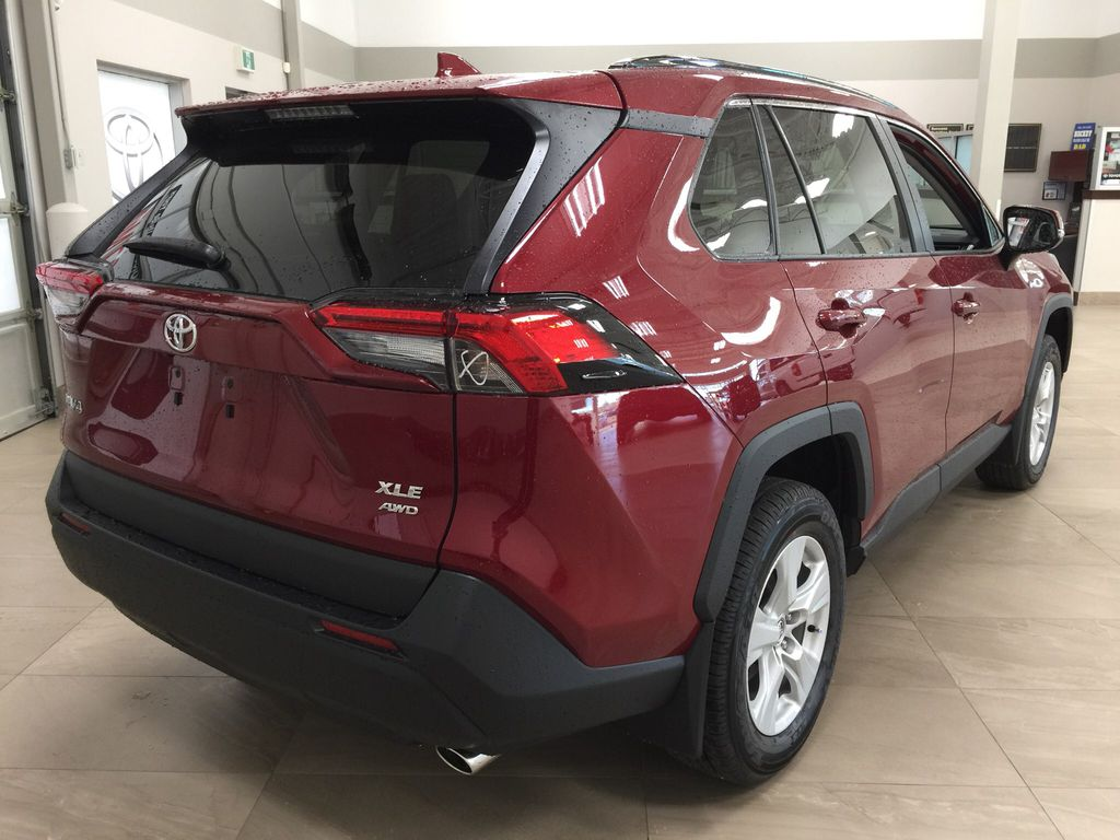Red[Ruby Flare Pearl] 2021 Toyota RAV4 XLE AWD Right Rear Corner Photo in Sherwood Park AB