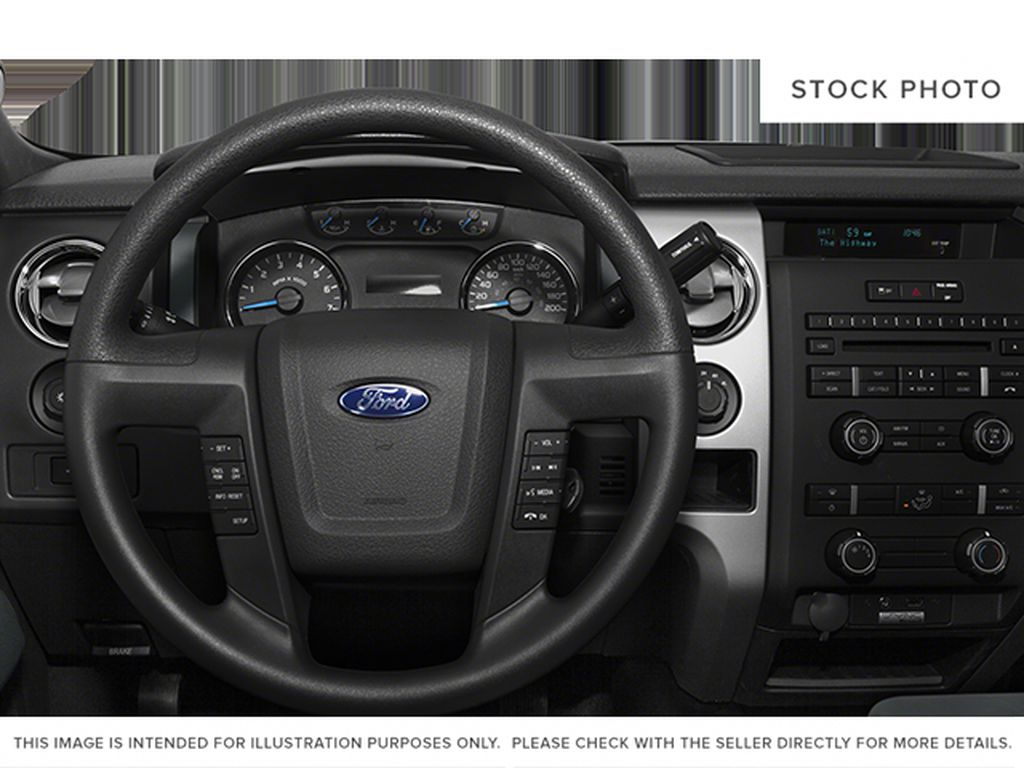 White[Oxford White] 2013 Ford F-150 Steering Wheel and Dash Photo in Fort Macleod AB
