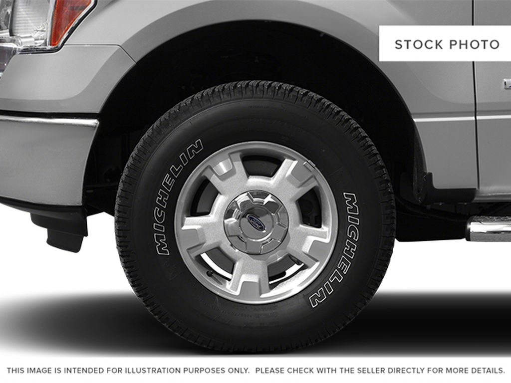 White[Oxford White] 2013 Ford F-150 Left Front Rim and Tire Photo in Fort Macleod AB