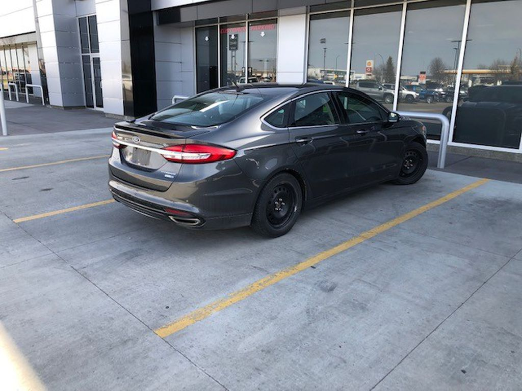 Grey 2017 Ford Fusion Left Front Interior Photo in Lethbridge AB