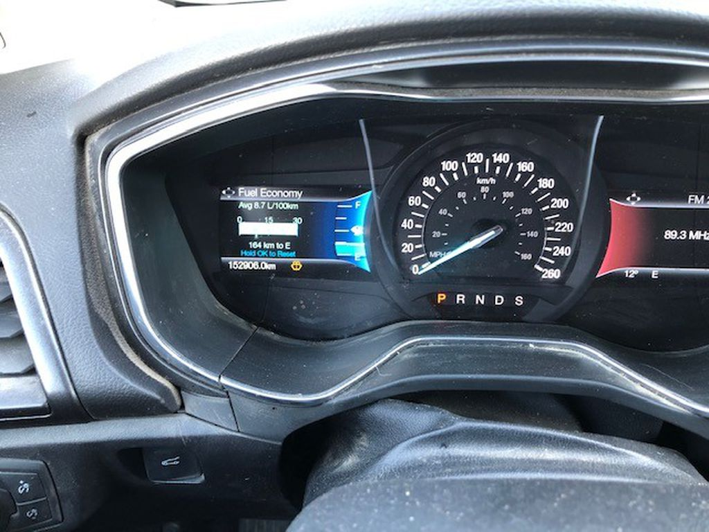 Grey 2017 Ford Fusion Left Front Head Light / Bumper and Grill in Lethbridge AB