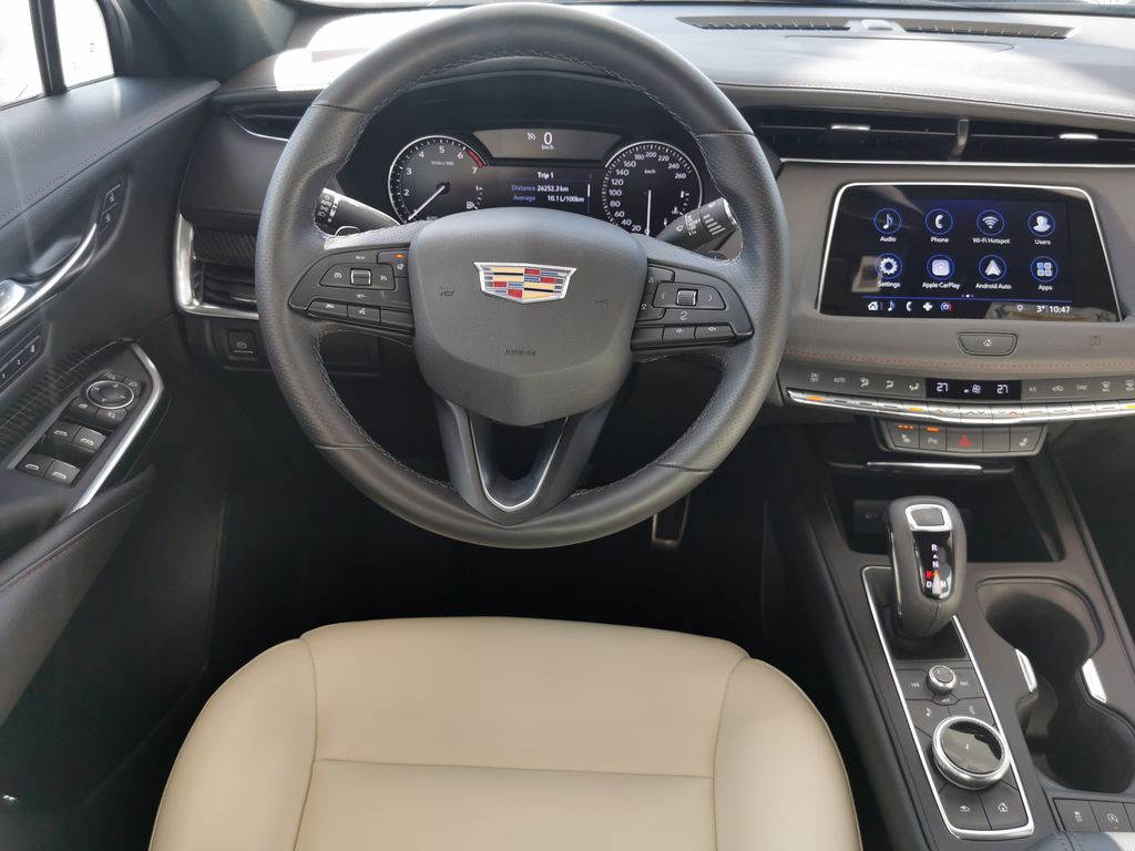White[Crystal White Tricoat] 2019 Cadillac XT4 Strng Wheel/Dash Photo: Frm Rear in Edmonton AB