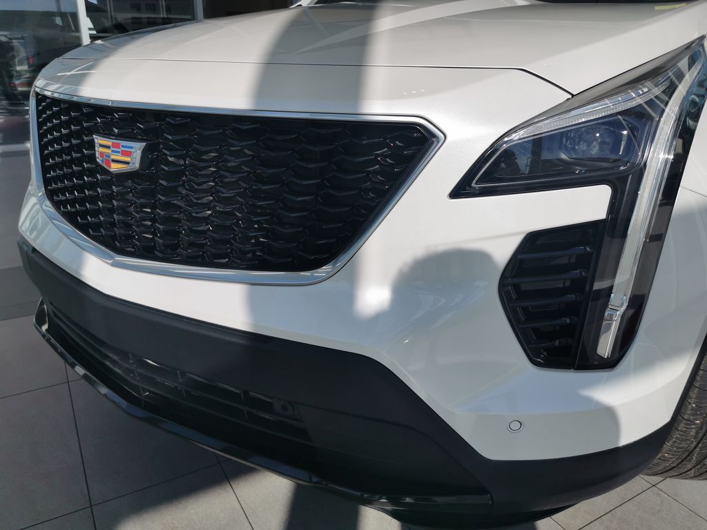 White[Crystal White Tricoat] 2019 Cadillac XT4 Left Front Head Light / Bumper and Grill in Edmonton AB