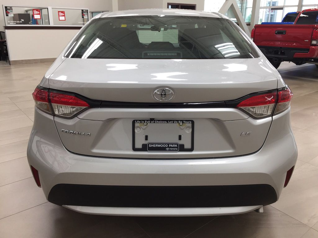 Silver[Classic Silver Metallic] 2021 Toyota Corolla LE Upgrade Rear of Vehicle Photo in Sherwood Park AB