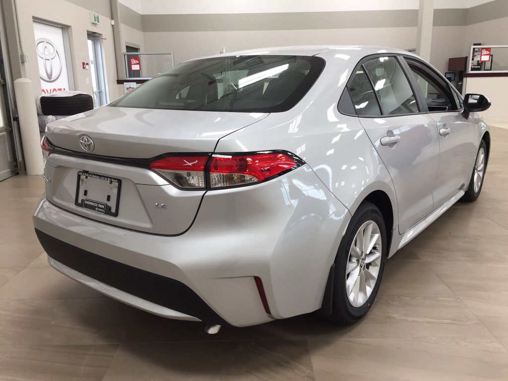 Silver[Classic Silver Metallic] 2021 Toyota Corolla LE Upgrade Right Rear Corner Photo in Sherwood Park AB