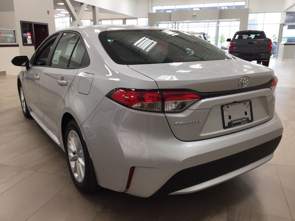 Silver[Classic Silver Metallic] 2021 Toyota Corolla LE Upgrade Left Rear Corner Photo in Sherwood Park AB