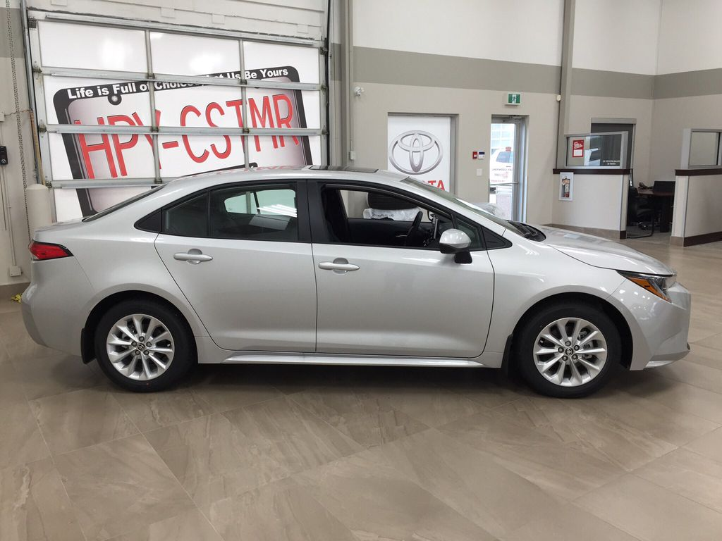 Silver[Classic Silver Metallic] 2021 Toyota Corolla LE Upgrade Right Side Photo in Sherwood Park AB