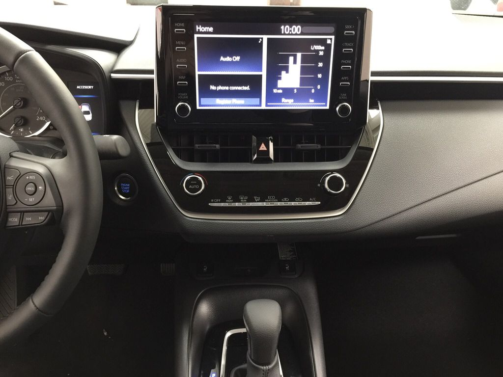 Silver[Classic Silver Metallic] 2021 Toyota Corolla LE Upgrade Central Dash Options Photo in Sherwood Park AB