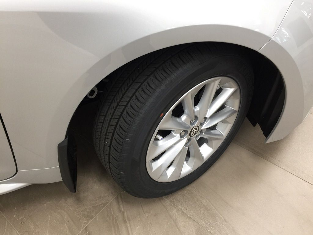 Silver[Classic Silver Metallic] 2021 Toyota Corolla LE Upgrade Right Front Rim and Tire Photo in Sherwood Park AB