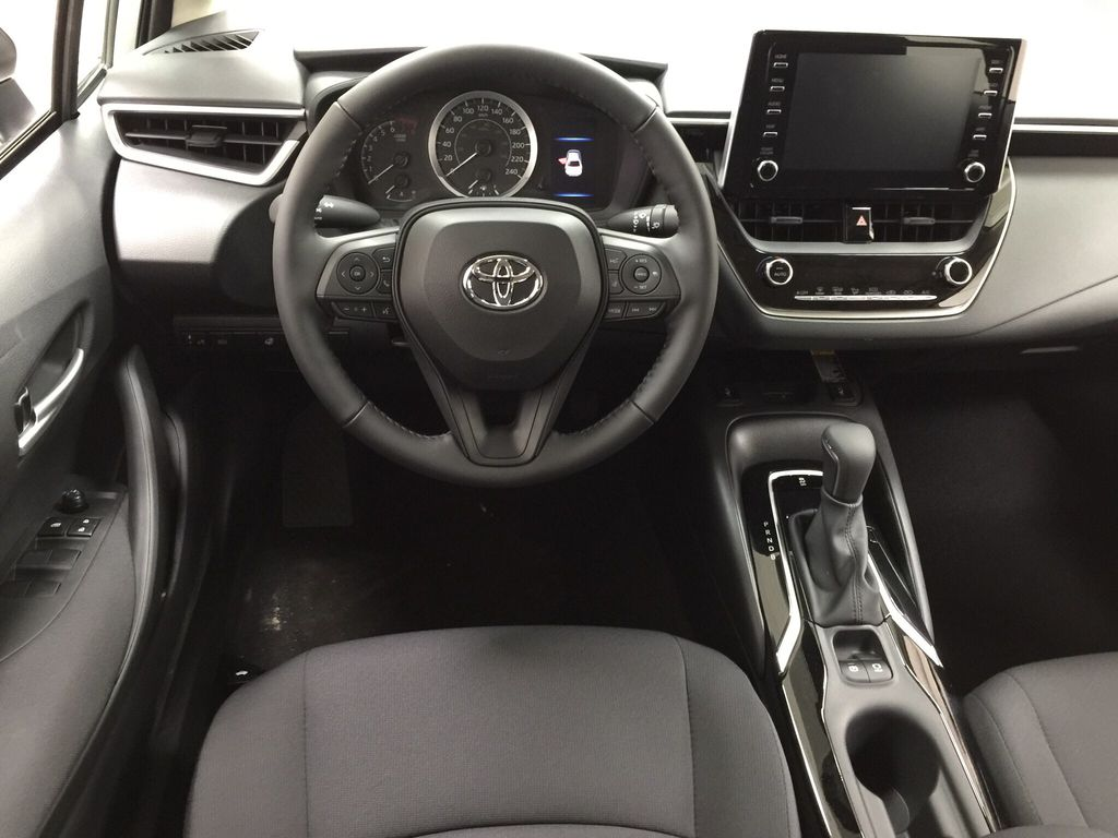 Silver[Classic Silver Metallic] 2021 Toyota Corolla LE Upgrade Left Front Seat Photo in Sherwood Park AB