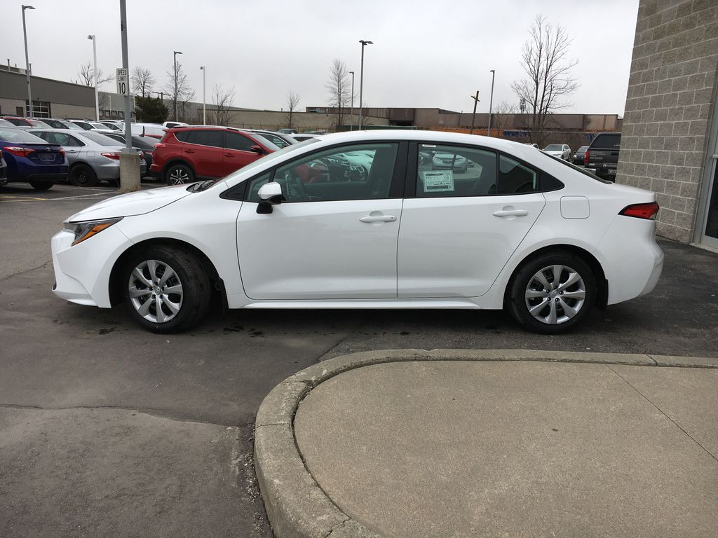 White[Blizzard Pearl] 2021 Toyota Corolla LE Standard Package BPRBLC AM Front Vehicle Photo in Brampton ON