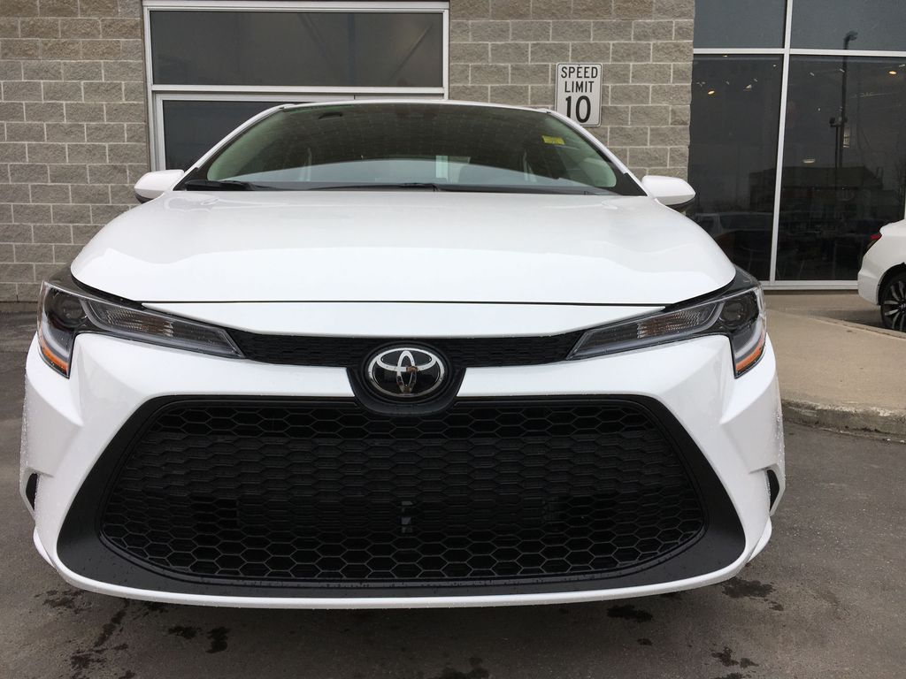 White[Blizzard Pearl] 2021 Toyota Corolla LE Standard Package BPRBLC AM Left Front Interior Photo in Brampton ON