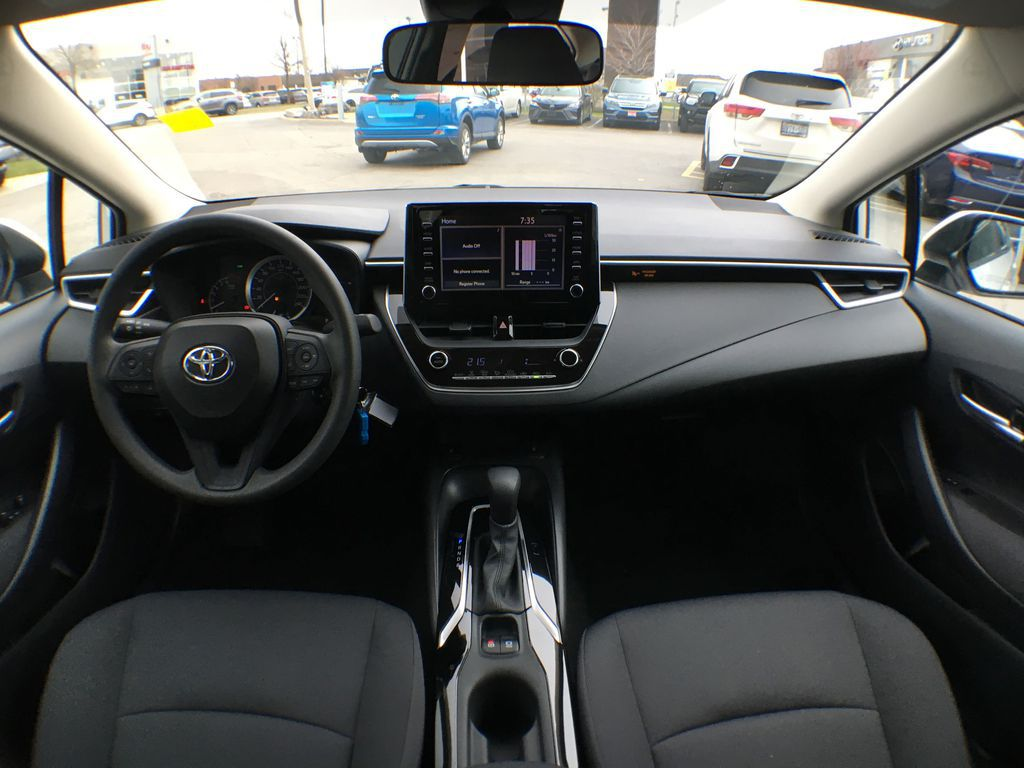 White[Blizzard Pearl] 2021 Toyota Corolla LE Standard Package BPRBLC AM Center Console Photo in Brampton ON