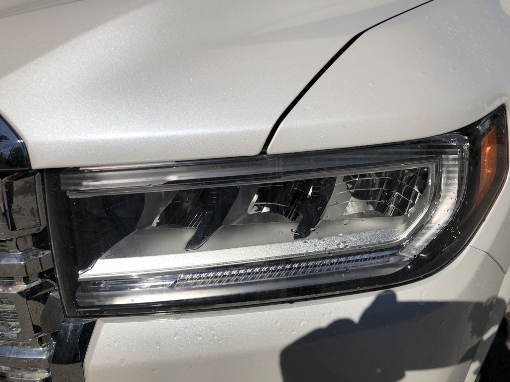 White[White Frost Tricoat] 2021 GMC Acadia Denali Left Front Head Light / Bumper and Grill in Canmore AB