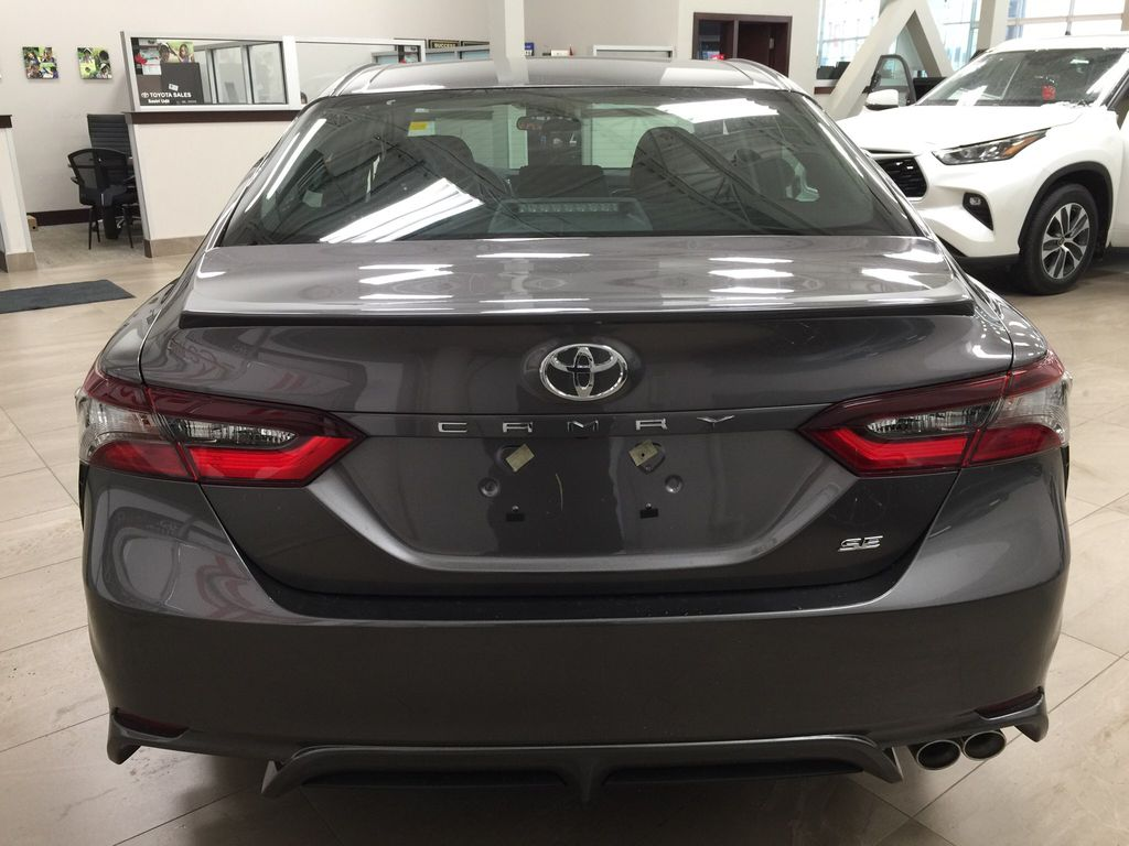 Gray[Pre-Dawn Grey Mica] 2021 Toyota Camry SE FWD Rear of Vehicle Photo in Sherwood Park AB