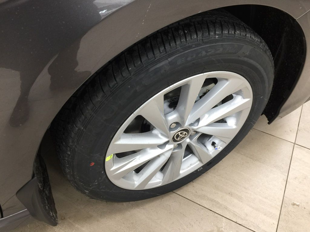 Gray[Pre-Dawn Grey Mica] 2021 Toyota Camry SE FWD Right Front Rim and Tire Photo in Sherwood Park AB