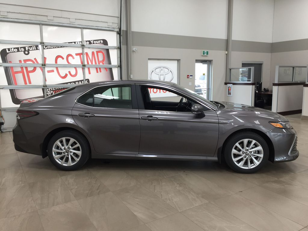 Gray[Pre-Dawn Grey Mica] 2021 Toyota Camry LE Hybrid Right Side Photo in Sherwood Park AB