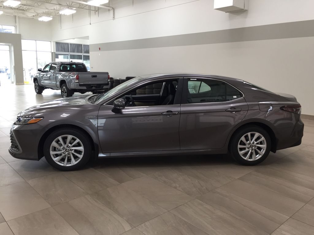 Gray[Pre-Dawn Grey Mica] 2021 Toyota Camry LE Hybrid Left Side Photo in Sherwood Park AB