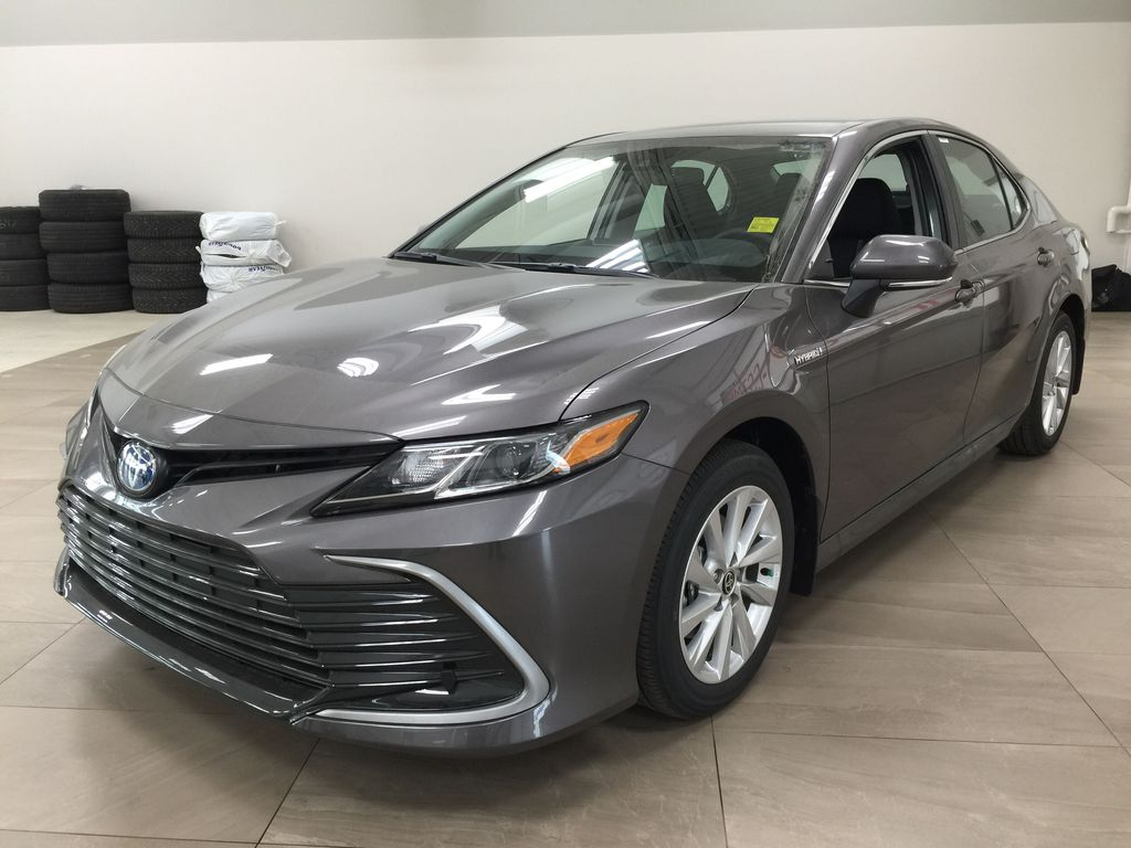 Gray[Pre-Dawn Grey Mica] 2021 Toyota Camry LE Hybrid Left Front Corner Photo in Sherwood Park AB