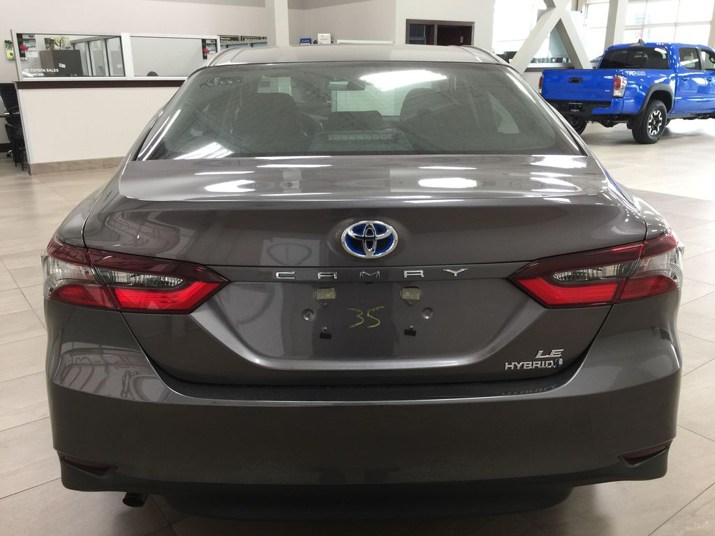 Gray[Pre-Dawn Grey Mica] 2021 Toyota Camry LE Hybrid Rear of Vehicle Photo in Sherwood Park AB
