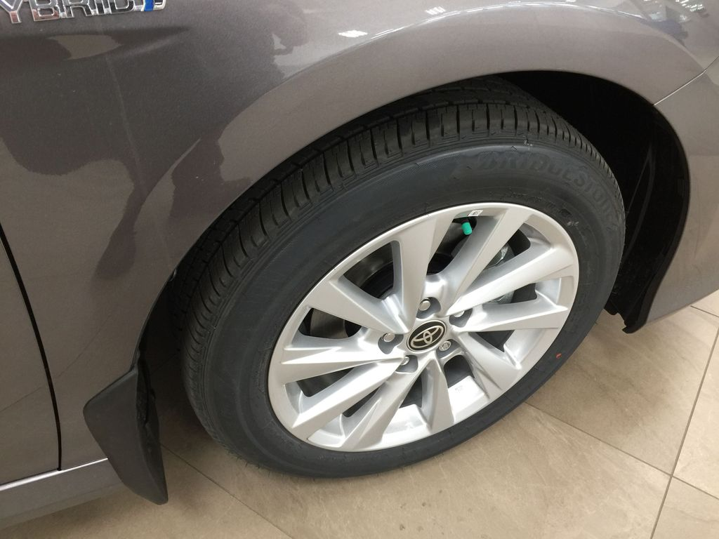 Gray[Pre-Dawn Grey Mica] 2021 Toyota Camry LE Hybrid Right Front Rim and Tire Photo in Sherwood Park AB