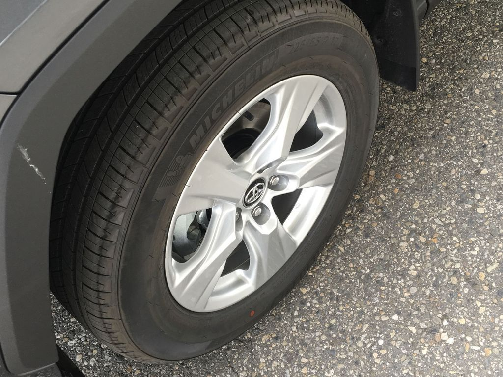 Gray[Magnetic Grey Metallic] 2021 Toyota RAV4 Left Front Rim and Tire Photo in Kelowna BC
